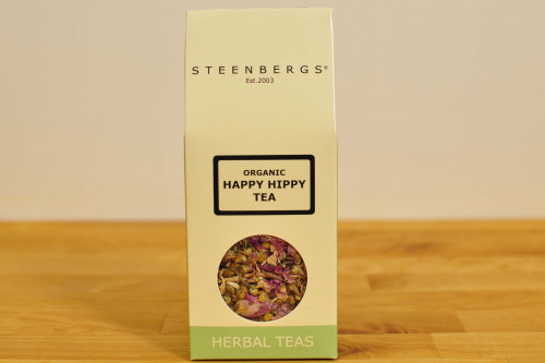 Steenbergs Organic Happy Hippy Loose Leaf Herbal Tea, a floral mix of chamomile, rose with mint, caffeine free, from the Steenbergs UK online shop for organic loose leaf herbal teas.