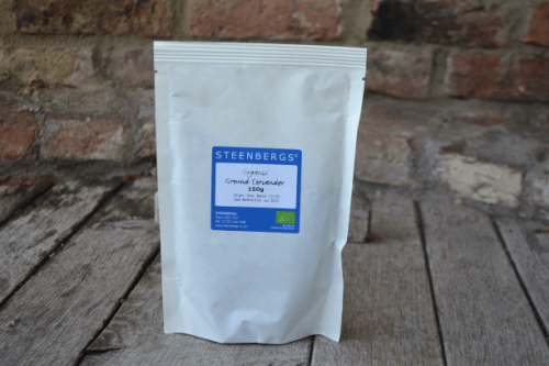 Steenbergs Organic Coriander Powder 150g in heat sealed paper bags from the Steenbergs UK online shop for organic herbs and spices.