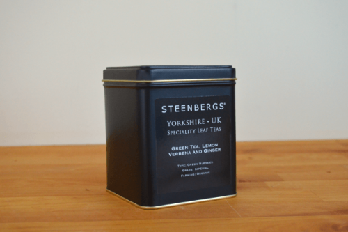 Steenbergs Organic Green Tea with Lemon Verbena and Ginger Loose Leaf tea in a tea caddy from the Steenbergs UK online specialist loose leaf tea shop.