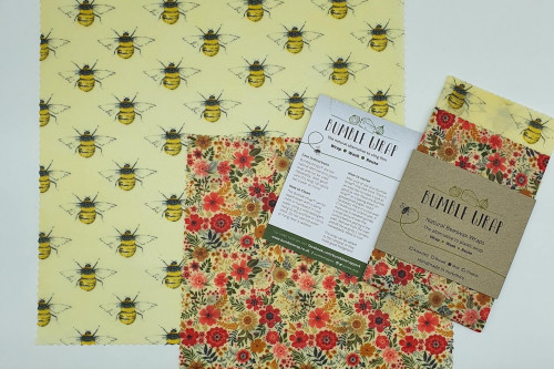 Two sheets of reusable plastic free food wrap, midi size, bumble bee design, made in York, North Yorkshire and available from Steenbergs UK online shop for ecofriendly kitchen items.