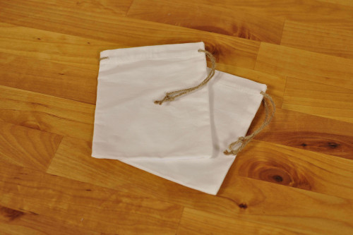 2 hand sewn calico bags with hessian strings - great for gifts - available from the Steenbergs UK online shop.