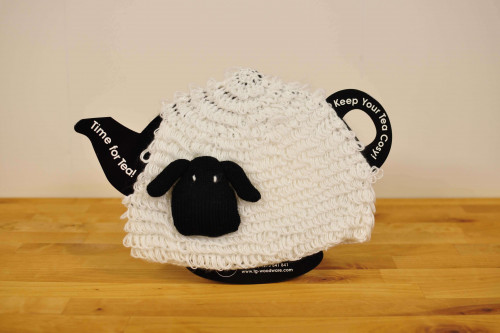Knitted Sheep Tea Cosy to keep your teapot and the tea inside warm, from the Steenbergs UK online shop for tea and tea accessories.