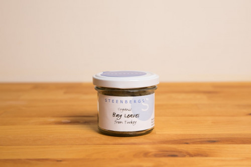 Steenbergs Organic Bay Leaves Dried in a reusable or recyclable glass jar, available at the UK Steenbergs online shop for herbs and spices.